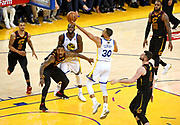 May 31, 2018; Oakland, CA, USA; Golden State Warriors guard Stephen Curry (30) shoots the ball against Cleveland Cavaliers center Kevin Love (0) during the fourth quarter in game one of the 2018 NBA Finals at Oracle Arena.