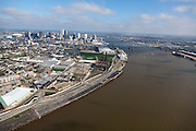 Abandoned wharfs on the up river side of New Orleans, note power plant and rail line.