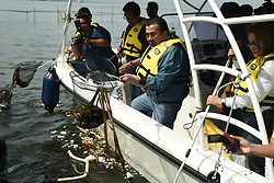 July 21, 2017 - Manila, Philippines - Former Philippine President, current Manila Mayor Joseph Ejercito Estrada leads the clean up drive of Manila Bay waters on 21 July 2017. On December 18, 2008, the Supreme Court issued a writ of continuing mandamus directing government agencies to clean up, rehabilitate and eventually preserve Manila Bay and was given 10 years to comply. (Credit Image: © George Calvelo/NurPhoto via ZUMA Press)