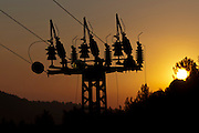 High voltage power line pylon at sunset