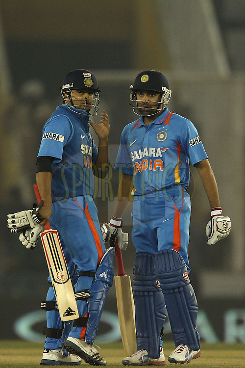 Suresh Raina of India and Rohit Sharma of India during the 4th Airtel ODI Match between India and England held at the PCA Stadium, Mohal, India on the 23rd January 2013..Photo by Ron Gaunt/BCCI/SPORTZPICS ..Use of this image is subject to the terms and conditions as outlined by the BCCI. These terms can be found by following this link:..http://www.sportzpics.co.za/image/I0000SoRagM2cIEc