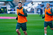 Leeds United midfielder Jack Harrison (22) warming up during the EFL Sky Bet Championship match between Huddersfield Town and Leeds United at the John Smiths Stadium, Huddersfield, England on 7 December 2019.
