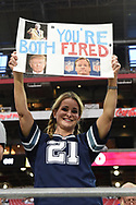 GLENDALE, AZ - SEPTEMBER 25:  A Dallas Cowboy fan holds a sign stating 'You're both fired' prior to the NFL game between the Dallas Cowboys and Arizona Cardinals at University of Phoenix Stadium on September 25, 2017 in Glendale, Arizona.  (Photo by Jennifer Stewart/Getty Images)