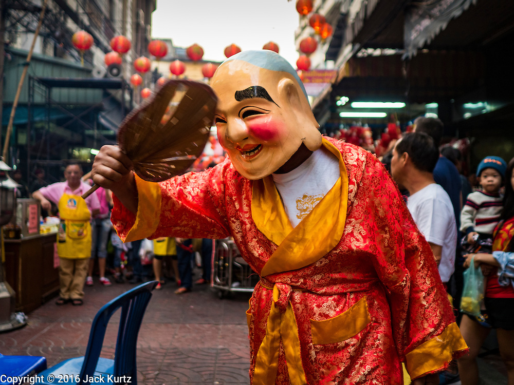 "08 FEBRUARY 2016 - BANGKOK, THAILAND:  A member of a lion dance troupe performs for Chinese New Year at a small Chinese shrine in Bangkok's Chinatown district, during the celebration of the Lunar New Year. Chinese New Year is also called Lunar New Year or Tet (in Vietnamese communities). This year is the ""Year of the Monkey."" Thailand has the largest overseas Chinese population in the world; about 14 percent of Thais are of Chinese ancestry and some Chinese holidays, especially Chinese New Year, are widely celebrated in Thailand.      PHOTO BY JACK KURTZ"