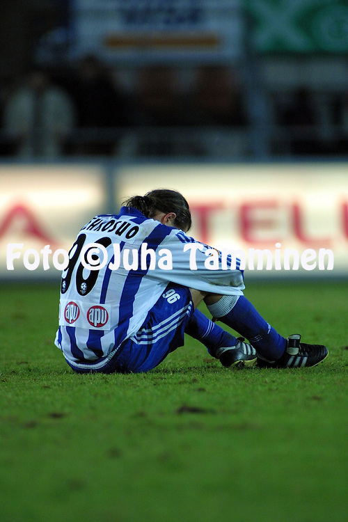 27.10.2001, Finnair Stadium, Helsinki, Finland. Veikkausliiga / Finnish League, HJK Helsinki v FC Haka Valkeakoski. .Dejected captain Mika Lehkosuo (HJK) after the match. HJK lost the League championship title by failing to beat Haka in the last match of the season. .©JUHA TAMMINEN