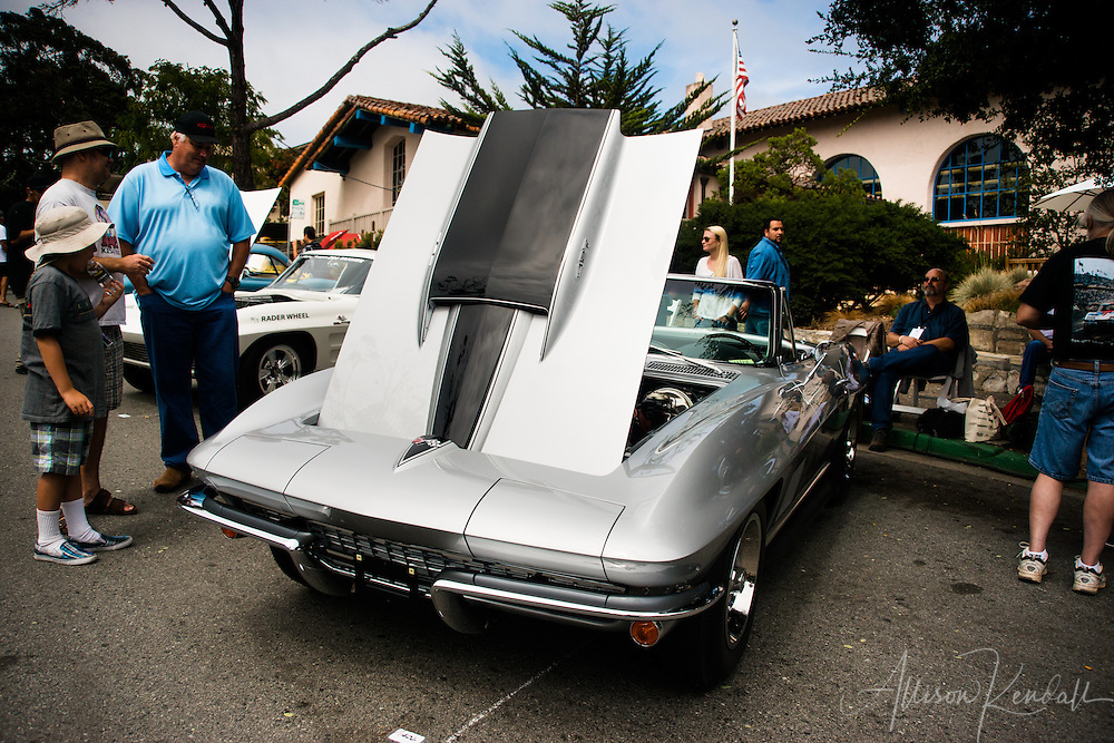 Spectators enjoy the cars and sunshine of the Carmel-by-the-Sea Concours on the Avenue event during Monterey Car Week