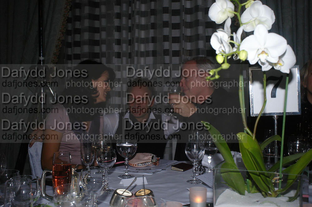 Polly Sampson, Stingand David Gilmour. Conde Nast Traveller Tsunami Appeal dinner. Four Seasons  Hotel. Hamilton Place, London W1. 2 March 2005. ONE TIME USE ONLY - DO NOT ARCHIVE  © Copyright Photograph by Dafydd Jones 66 Stockwell Park Rd. London SW9 0DA Tel 020 7733 0108 www.dafjones.com