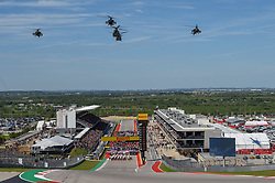 October 21, 2018 - Austin, TX, U.S. - AUSTIN, TX - OCTOBER 21: An Army helicopter formation flies over as the conclusion of the National Anthem before the F1 United States Grand Prix on October 21, 2018, at Circuit of the Americas in Austin, TX. (Photo by Ken Murray/Icon Sportswire) (Credit Image: © Ken Murray/Icon SMI via ZUMA Press)