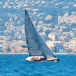 A racing yacht cruising offshore of Cannes, France