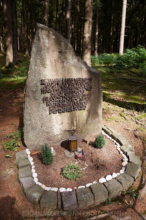 memorial stone at the Ochsenkopf in the Huertgen forest near Raffelsbrand, here the common grave of three fallen soldiers of World War 2 was found in May 1976, North Rhine-Westphalia, Germany.<br /> <br /> Gedenkstein am Ochsenkopf im Huertgenwald bei Raffelsbrand, hier wurde im  Mai 1976 das gemeinsame Grab von drei gefallenen Soldaten des 2. Weltkrieges gefunden, Nordrhein-Westfalen, Deutschland.