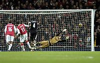 Photo: Olly Greenwood.<br />Arsenal v Charlton Athletic. The Barclays Premiership. 02/01/2007. Arsenal's Robin Van Persie scores a penalty past Charlton's Scott Carson