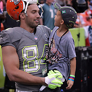 Cleveland Brown's Tight End,  Jordan Cameron (Cravens Family), looks upon his son with great pride during the NFL Pro Bowl Game at Aloha Stadium, Honolulu, Hawaii.  1/26/14, Photo by Abe Markowitz, Courtesy STP/TriMarine.
