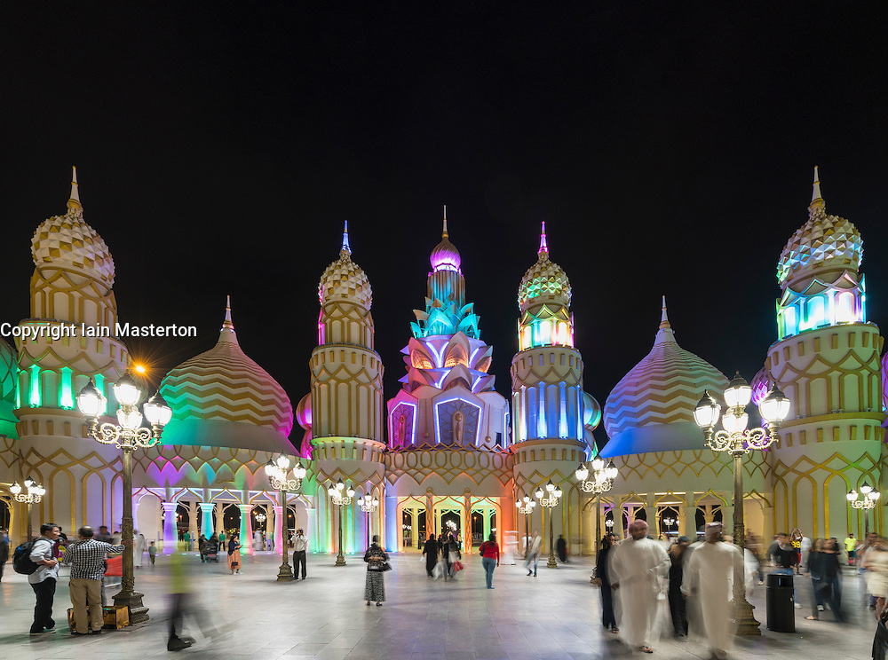 Evening view of illuminated Gate of the World at Global Village 2015 in Dubai United Arab Emirates