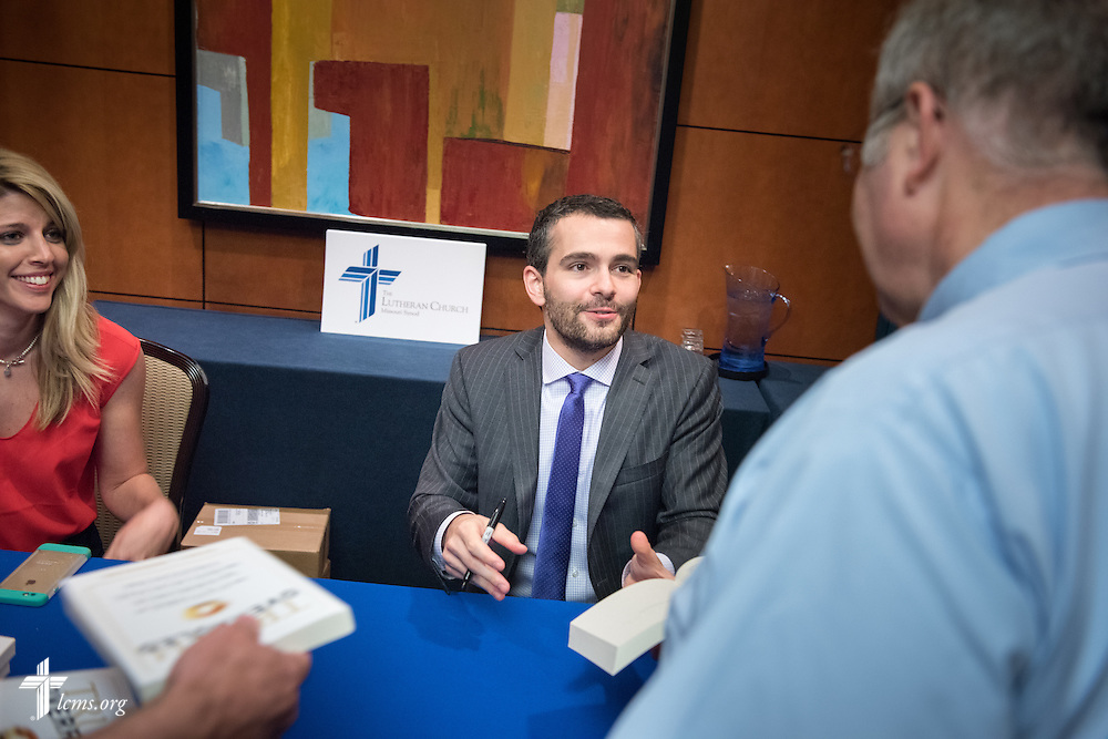 """Dr. Ryan Anderson, author of the book """"Truth Overruled: The Future of Marriage and Religious Liberty,"""" signs books at the Let's Talk Life, Marriage and Religious Liberty event on Wednesday, Sept. 9, 2015, in Washington, D.C. LCMS Communications/Erik M. Lunsford"""