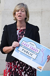 © Licensed to London News Pictures. 18/10/2013. London, UK. Labour Rail Minister, Lilian Greenwood is seen talking at a protest against the re-privatisation of the United Kingdom's East Coast Line in London today (18/10/2013) ahead of handing in a petition consisting of 23,000 commuter's signatures to the transport ministry. The East Coast Line, which runs from London to Scotland, is currently the only publicly owned train line after passing to the government from previous operator National Express who encountered financial difficulties. Photo credit: Matt Cetti-Roberts/LNP