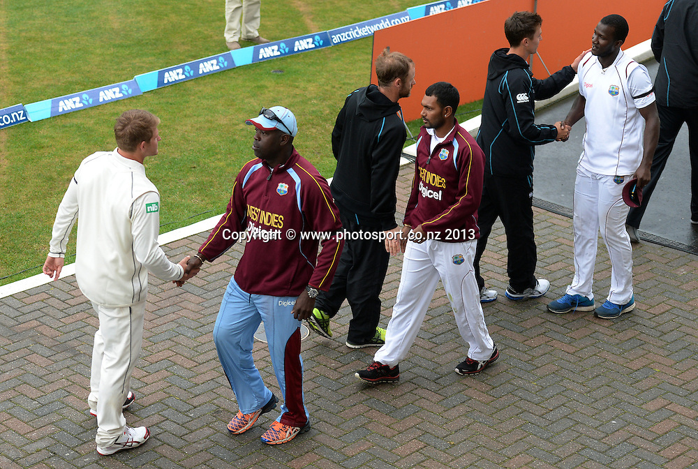 Players shake hands as the match ends in a draw on Day 5 of the 1st cricket test match of the ANZ Test Series. New Zealand Black Caps v West Indies at University Oval in Dunedin. Saturday 7 December 2013. Photo: Andrew Cornaga/www.Photosport.co.nz