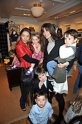 ELEN RIVES and her daughter LUNA LAMPARD with LISA BILTON and her son at 'Paint Your Polo Celebration' a children's party in aid of the charity Clic Sargent held at Ralph Lauren, 139/141 Fulham Road, London on 28th April 2009.