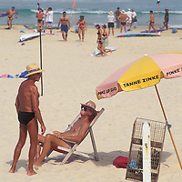 Australia, NSW, Sunbathers at Bondi Beach near Sydney on a sunny afternoon.