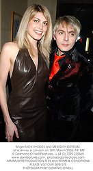 Singer NICK RHODES and MEREDITH OSTROM,  at a dinner in London on 19th March 2003.	PIE 142