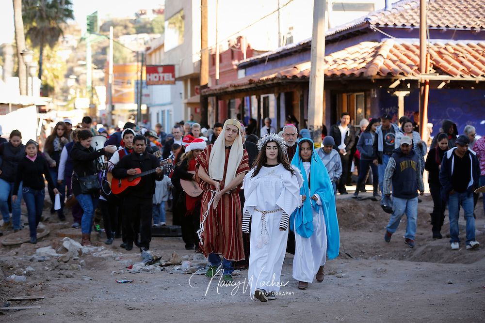 Kino Border Initiative bi-national posada, December 20, 2105, in Nogales, Sonora. A recollection of Mary and Joseph's search for a place to give birth to Jesus. Bishops  Gerald F. Kicanas of Tucson and Jose Leopoldo Gonzalez Gonzalez of Nogales, Sonora, took part in the procession. Kenia Salas, 17, of Salpoint High School and Saul Gonzalez, 17, of Lourdes Catholic High School played the roles of Mary and Joseph. The angel was played by Zuhaila Parra, a junior at Lourdes Catholic High School. (CNS photo/Nancy Wiechec)