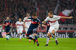December 16, 2017 - Stuttgart, Germany - Bayerns Thomas Mueller in a duel with Stuttgarts Holger Badstuber during the German first division Bundesliga football match between VfB Stuttgart and Bayern Munich on December 16, 2017 in Stuttgart, Germany. (Credit Image: © Bartek Langer/NurPhoto via ZUMA Press)