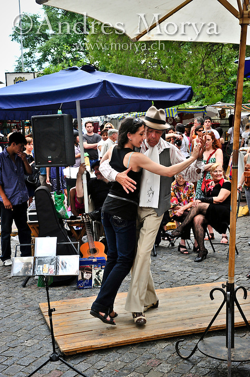 Tango Dancers dancing in the San Telmo market in Buenos Aires , Argentina Image by Andres Morya
