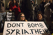 UNITED KINGDOM, London: 02 December 2015 A young lady sits in shock at the result of the decision to go ahead and bomb Syria after a historic Commons vote. Thousands of people gathered in Parliament Square this evening as part of a Stop The War campaign. Protesters have gathered outside Parliament for a second night as they await the result of a vote on UK air strikes in Syria. <br /> Rick Findler / Story Picture Agency