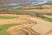 Aerial view of harvested farm fields and woods in northeast Iowa along the Mississippi River.