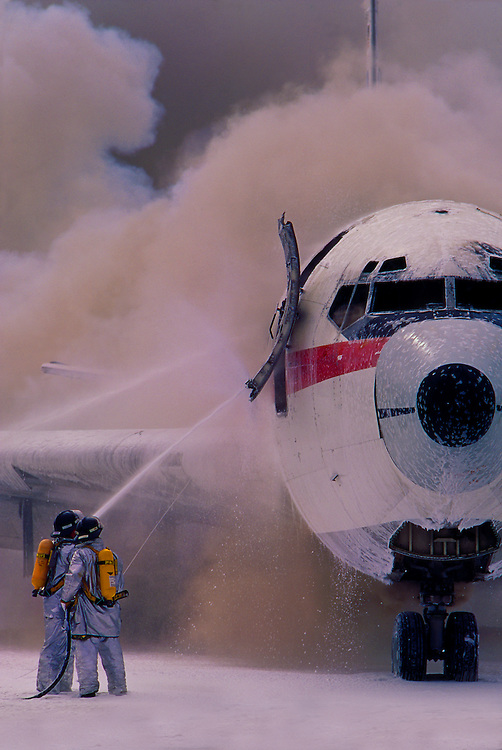 Burning passenger jet with firefighters, emergency exercise, San Francisco International Airport, San Bruno, California