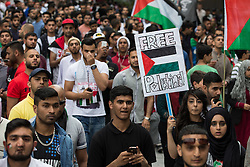 """© Licensed to London News Pictures . 12/07/2014 . Manchester , UK . Thousands of people outside the BBC at Media City in Salford , Greater Manchester , this afternoon (Saturday 12th July 2014) , protesting Israeli actions in Gaza and the Corporation's coverage of the Israeli Palestinian conflict . A convey branded """" Drive for Justice """" travelled from out of the city from Bradford , Blackburn and other regions , to form the protest . Photo credit : Joel Goodman/LNP"""