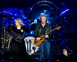 © Licensed to London News Pictures. 24/09/2013. London, UK.   Fleetwood Mac performing live at The O2 Arena.  In this pic - Stevie Nicks (left), Mick Fleetwood (centre, drums), Lindsey Buckingham (right). Fleetwood Mac are a British-American rock band formed in 1967 in London consisting of Mick Fleetwood (drums), John McVie (bass), Lindsey Buckingham (guitar/vocals) and Stevie Nicks (vocals).  Photo credit : Richard Isaac/LNP
