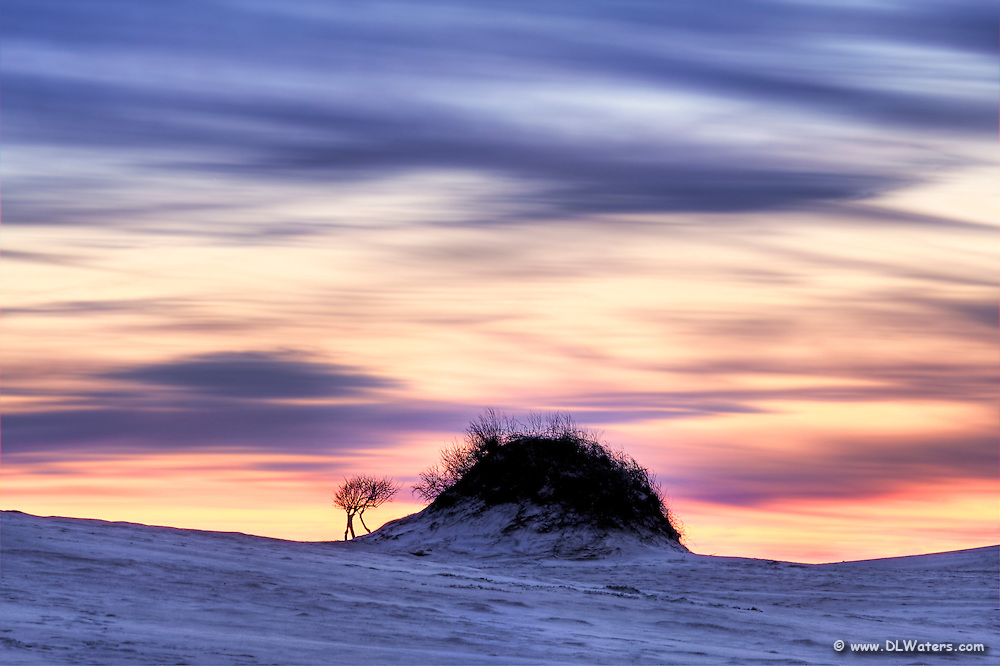 This is a long evening exposure of Jockeys Ridge State Park.  Jockey' s Ridge is the tallest natural sand dune system in the Eastern United States. Located in Nags Head, it is one of the most significant landmarks on the Outer Banks, North Carolina.
