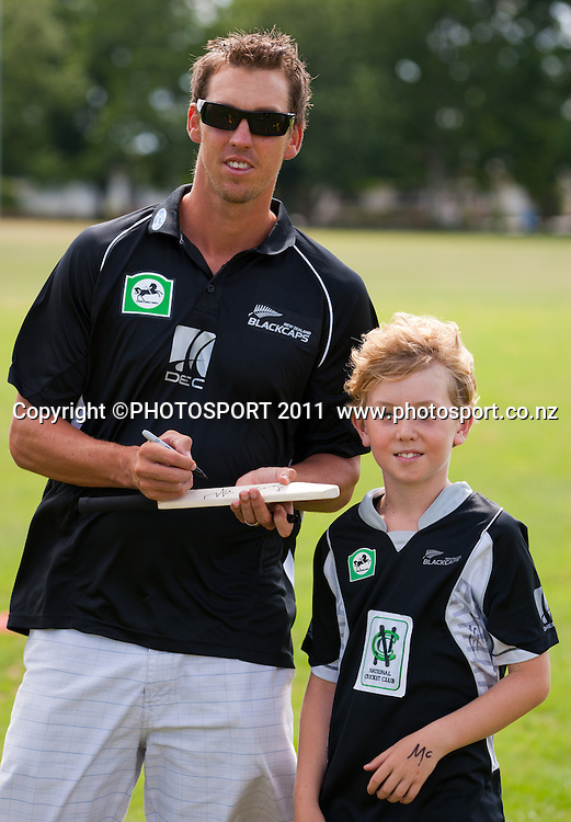 Brent Arnel signs an autograph for Cullen Thomas (9) during the NCC Super Camp for Primary School players, an initiative by The National Bank to connect with the grass roots of cricket, hosted by Hamilton Star University Cricket Club, Waikato University, Hamilton, New Zealand, Wednesday 5 January 2011. Photo: Stephen Barker/PHOTOSPORT