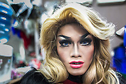 A dragqueen poses for a portrait while waiting to perform in a gay bar in busy touristic street of Kuta, Bali, Indonesia.