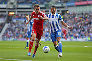 Scott Malone of Cardiff City battles with Brighton defender, full back, Liam Rosenior during the Sky Bet Championship match between Brighton and Hove Albion and Cardiff City at the American Express Community Stadium, Brighton and Hove, England on 3 October 2015. Photo by Phil Duncan.