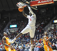"Mississippi Rebels forward M.J. Rhett (4) dunks against Tennessee Volunteers forward Willie Carmichael III (24) and Tennessee Volunteers guard Robert Hubbs III (3) at the C.M. ""Tad"" Smith Coliseum in Oxford, Miss. on Saturday, February 21, 2015. (AP Photo/Oxford Eagle, Bruce Newman)"