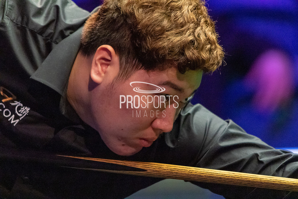 Action from the first session on Day 2 between Yan Bingtao Vs Barry Pinches during 19.com Scottish Open Snooker Championships at the Emirates Arena  Glasgow, Scotland on 9 December 2019.
