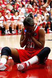March 21, 2011; Stanford, CA, USA; St. John's Red Storm forward Centhya Hart (30) reacts after committing a foul against the Stanford Cardinal during the second half of the second round of the 2011 NCAA women's basketball tournament at Maples Pavilion. Stanford defeated St. John's 75-49.