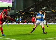 The ball hits the arm of George Edmundson (#4) of Rangers FC to give away a penalty after a VAR review during the Europa League Round of 16 match between Rangers FC and Bayer Leverkusen at Ibrox Park, Glasgow, Scotland on 12 March 2020.