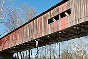 Cox Ford Covered Bridge was built in 1913 in Burr Arch style by J.A. Britton. A roof and red painted wood sides protect this historic bridge in Turkey Run State Park, in historic Parke County, Indiana, USA.