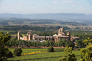 General view of Monestir de Poblet, 1151, and the surrounding landscape, Vimbodi, Catalonia, Spain, pictured on May 20, 2006 in the warm evening light.  The Monastery of Poblet belongs to the Cistercian Order and was founded by French monks. Originally, Cistercian architecture, like the rules of the order, was frugal. But continuous additions  including late Gothic and Baroque, eventually made Poblet one of the largest monasteries in Spain which was later used as a fortress and royal palace. It was closed in 1835 by the Spanish State but refounded in 1940 by Italian Cistercians. It is a UNESCO World Heritage Site and is surrounded by the beautiful Southern landscape. Picture by Manuel Cohen.
