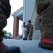 Lieutenant Maddy Cooper (Middle) uses hand gestures while explaining ladder technique during ladder training Wednesday, July 6, 2011, in Camden-Wyoming Delaware.