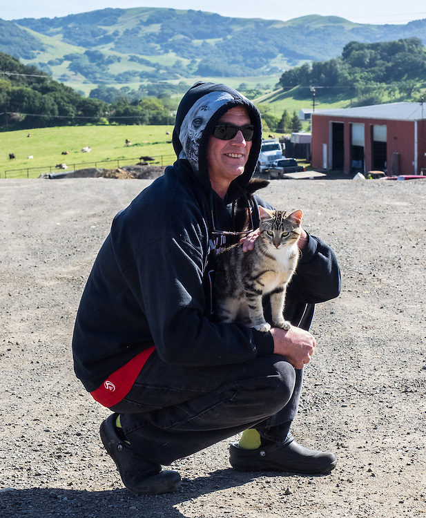 Mike adopts the cat at Pacheco Ranch & Achandinha Cheese Company