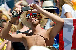 Fan with mobile phone at A1 Beach Volleyball Grand Slam tournament of Swatch FIVB World Tour 2010, bronze medal, on August 1, 2010 in Klagenfurt, Austria. (Photo by Matic Klansek Velej / Sportida)