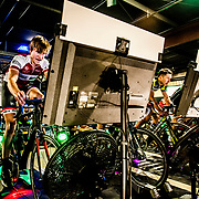 "ROANOKE, VA - MAR 9: Ben races in a virtual race using an app called ""Zwift"" against regional cycling talent, including Jeremiah Bishop, right, at Soaring Ridge Brewery on Thursday, Mar. 9, 2017 in Roanoke, Va. Bishop met Ben the previous year at a Gran Fondo ride that Bishop hosts, and noticed Ben's talents and has acted as a mentor. (Photo by Jay Westcott/The News & Advance)"