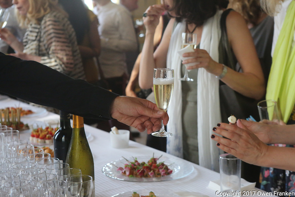 Pouring and serving Champagne at a gala party