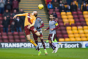 Motherwell FC Forward Louis Moult jumps for the ball during the Ladbrokes Scottish Premiership match between Motherwell and Heart of Midlothian at Fir Park, Motherwell, Scotland on 28 November 2015. Photo by Craig McAllister.
