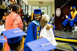 Senior class president and student of the year Kamille Willis gets a hug from Class of 1940 graduate Ruth Moolenar.  Charlotte Amalie High School 85th Annual Commencement Program at UVI Sports and Fitness Center.  14 June 2015.  © Aisha-Zakiya Boyd