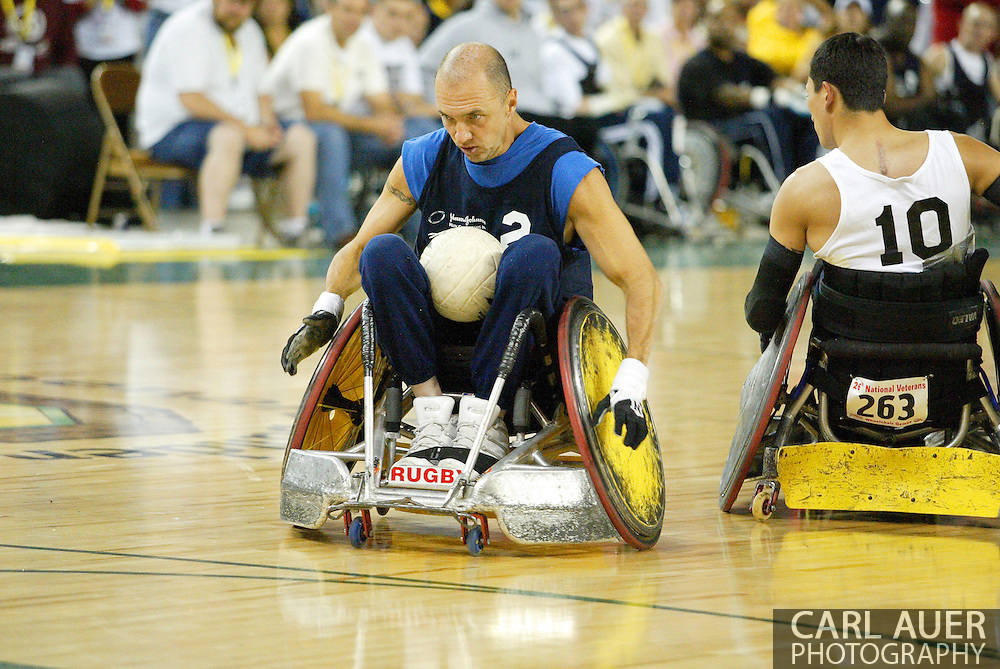 July 7th, 2006: Anchorage, AK - David Hosick (2) speeds past William Groulx (10) to score as White defeated Blue in the gold medal game of Quad Rugby at the 26th National Veterans Wheelchair Games.