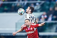 (L) Wisla's Dariusz Dudka fights for the ball with (R) Legia's Orlando Sa during T-Mobile ExtraLeague soccer match between Legia Warsaw and Wisla Krakow in Warsaw, Poland.<br /> <br /> Poland, Warsaw, March 15, 2015<br /> <br /> Picture also available in RAW (NEF) or TIFF format on special request.<br /> <br /> For editorial use only. Any commercial or promotional use requires permission.<br /> <br /> Mandatory credit:<br /> Photo by © Adam Nurkiewicz / Mediasport
